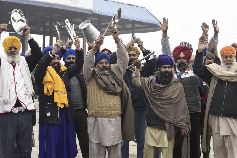PM India rayu petani tamatkan protes